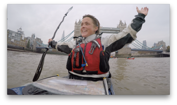 Sarah_hands in air kayak finish_Tower Bridge 2015
