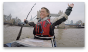 Sarah hands in air kayak finish Tower Bridge 2015